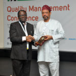 representative-of-the-lagos-state-commissioner-of-health-presenting-plague-to-dr-olaokun-soyinka